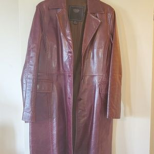 Leather trenchcoat by Coach.
